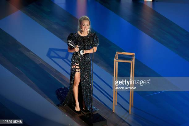 Carrie Underwood accepts the Entertainer of the Year award onstage during the 55th Academy of Country Music Awards at the Grand Ole Opry on September...