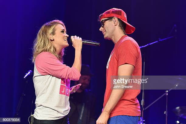 Carrie Underwood and Bobby Bones perform during The Raging Idiots' Million Dollar Show for St Jude at Ryman Auditorium on December 7 2015 in...