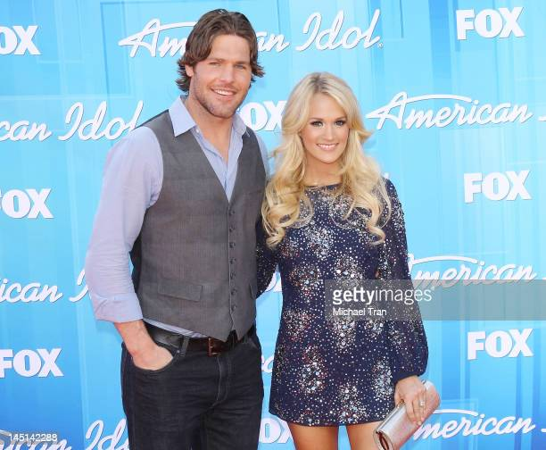 Carrie Underwood and husband Mike Fisher arrive at American Idol Season 11 grand finale show held at Nokia Theatre LA Live on May 23 2012 in Los...