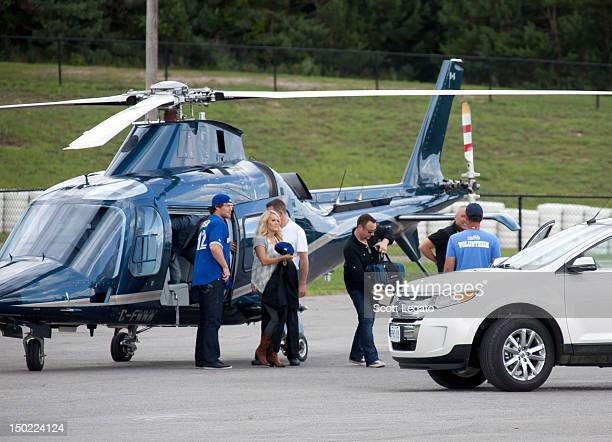 Carrie Underwood and husband Mike Fisher arrive at Boots and Hearts Festival on August 12 2012 in Bowmanville Canada