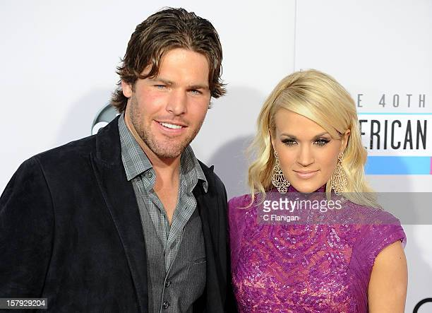 Carrie Underwood and husband Mike Fisher arrive at The 40th American Music Awards at Nokia Theatre LA Live on November 18 2012 in Los Angeles...