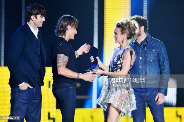 Carrie Underwood and Keith Urban accept the Collaborative Video award from Ashton Kutcher and Danny Masterson at the 2017 CMT Music Awards at the...