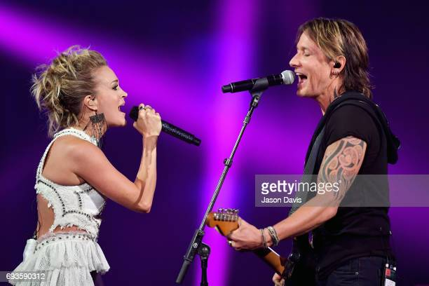 Carrie Underwood and Keith Urban perform onstage during the 2017 CMT Music Awards at the Music City Center on June 7 2017 in Nashville Tennessee