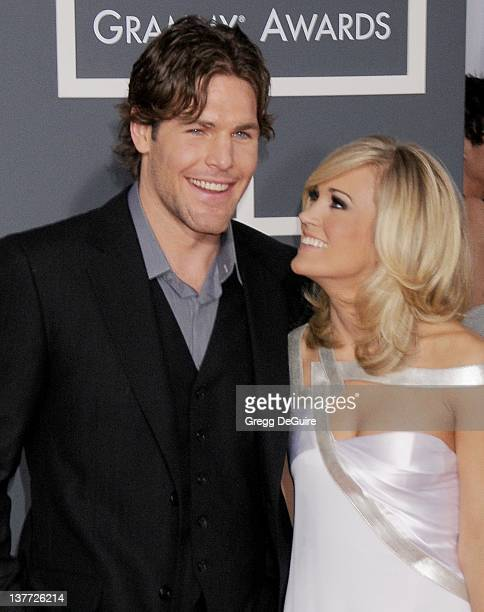 Carrie Underwood and Mike Fisher arrive at the 52nd Annual GRAMMY Awards held at the Nokia Theater on January 31 2010 in Los Angeles California