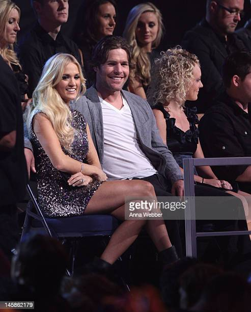 Carrie Underwood and Mike Fisher attend the 2012 CMT Music awards at the Bridgestone Arena on June 6 2012 in Nashville Tennessee