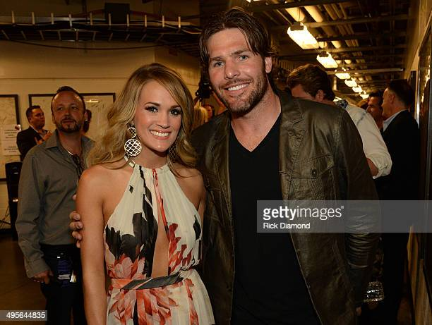 Carrie Underwood and Mike Fisher attend the 2014 CMT Music Awards at Bridgestone Arena on June 4 2014 in Nashville Tennessee