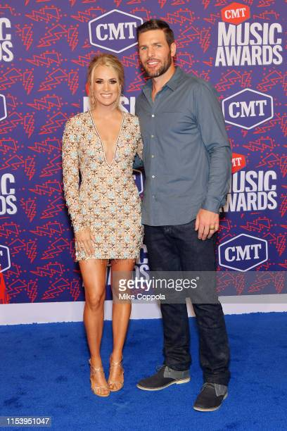 Carrie Underwood and Mike Fisher attend the 2019 CMT Music Award at Bridgestone Arena on June 05 2019 in Nashville Tennessee