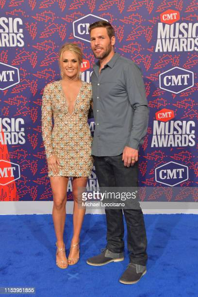Carrie Underwood and Mike Fisher attend the 2019 CMT Music Awards at Bridgestone Arena on June 05 2019 in Nashville Tennessee
