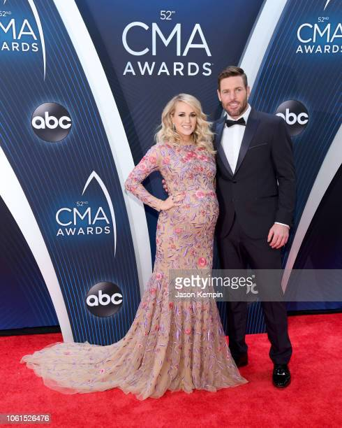 Carrie Underwood and Mike Fisher attend the 52nd annual CMA Awards at the Bridgestone Arena on November 14 2018 in Nashville Tennessee