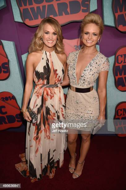 Carrie Underwood and Miranda Lambert attend the 2014 CMT Music awards at the Bridgestone Arena on June 4, 2014 in Nashville, Tennessee.