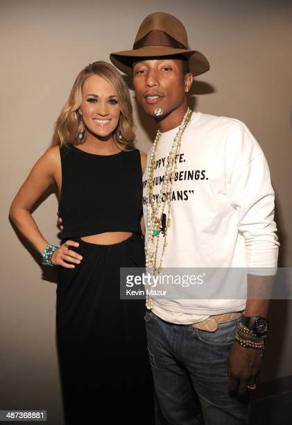 Carrie Underwood and Pharrell Williams backstage at the TIME 100 Gala TIME's 100 most influential people in the world at Jazz at Lincoln Center on...