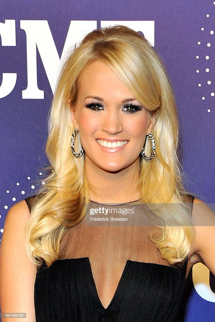 Carrie Underwood arrives at the 2012 CMT Artists Of The Year at The Factory At Franklin on December 3, 2012 in Franklin, Tennessee.