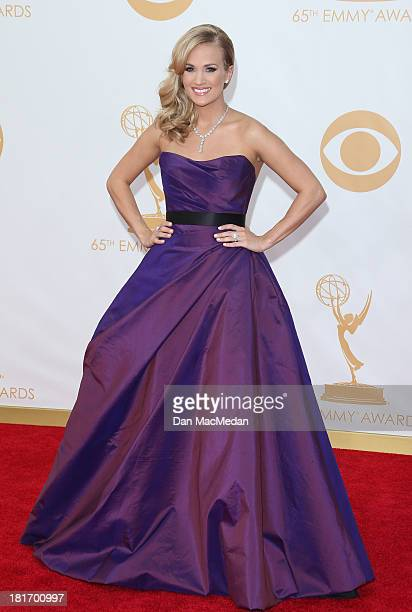 Carrie Underwood arrives at the 65th Annual Primetime Emmy Awards at Nokia Theatre LA Live on September 22 2013 in Los Angeles California