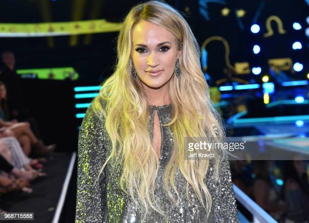 Carrie Underwood attends onstage at the 2018 CMT Music Awards at Bridgestone Arena on June 6 2018 in Nashville Tennessee