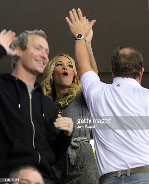 Carrie Underwood celebrates a Nashville Predators goal with friends against the Columbus Blue Jackets during an NHL game on April 8 2011 at...