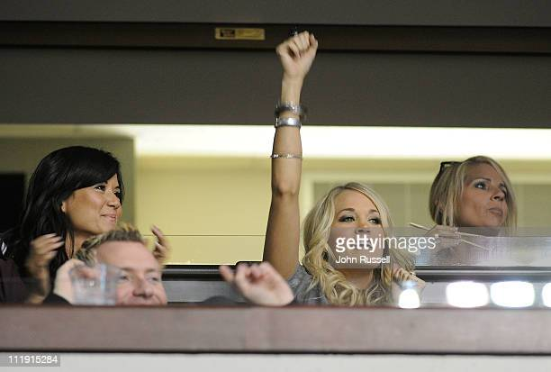 Carrie Underwood cheers during a game between the Nashville Predators and the Columbus Blue Jackets during an NHL game on April 8 2011 at Bridgestone...