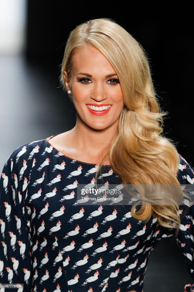 Carrie Underwood greets the audience before presenting the Project Runway Season 14 fashion show at The Arc, Skylight at Moynihan Station on September 11, 2015 in New York City.