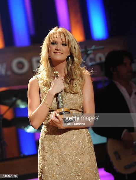 Carrie Underwood is inducted as the newest member of The Grand Ole Opry by fellow Opry member Garth Brooks Brooks presented Underwood with The Opry...