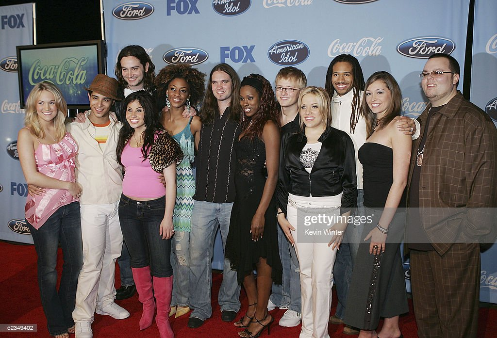 , Carrie Underwood, Mario Vasquez, Mikalah Gordon, Constantine Maroulis, Nadia Turner, Bo Bice, Vonzell Solomon, Anthony Fedorov, Jessica Sierra, Anwar Robinson, Lindsey Cardinale and Scott Savol pose at a party to celebrate the 'American Idol' Top 12 Finalists at Astra West on March 9, 2005 in West Hollywood, California.