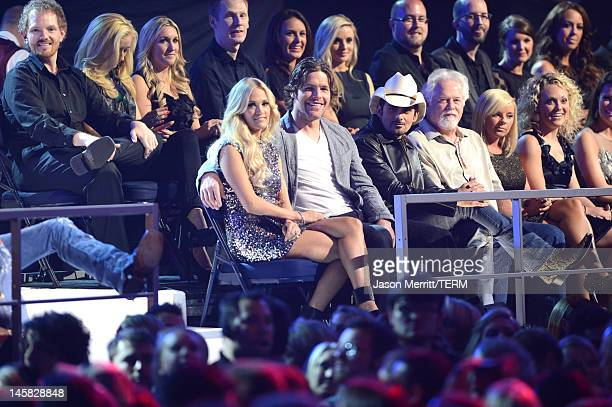 Carrie Underwood Mike Fisher and Brad Paisley attend the 2012 CMT Music awards at the Bridgestone Arena on June 6 2012 in Nashville Tennessee