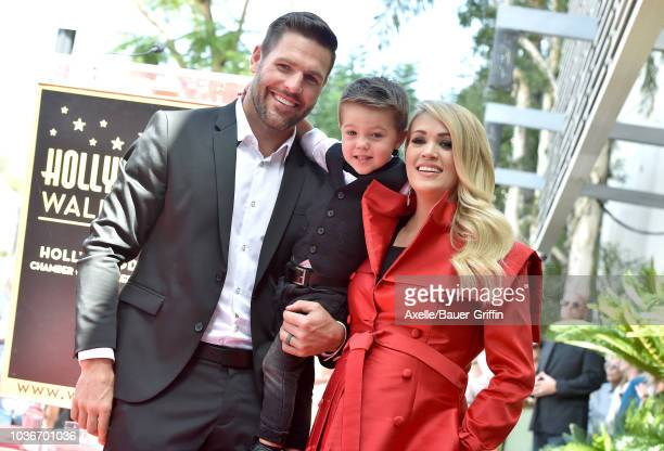 Carrie Underwood Mike Fisher and Isaiah Michael Fisher attend the ceremony honoring Carrie Underwood with star on the Hollywood Walk of Fame on...