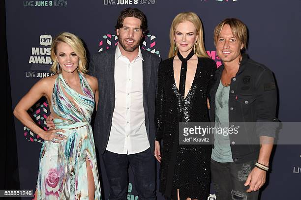 Carrie Underwood Mike Fisher Nicole Kidman and Keith Urban attend the 2016 CMT Music awards at the Bridgestone Arena on June 8 2016 in Nashville...