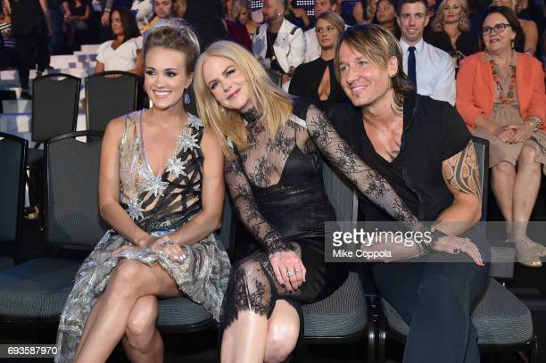Carrie Underwood Nicole Kidman and Keith Urban pose in the audience during the 2017 CMT Music Awards at the Music City Center on June 6 2017 in...