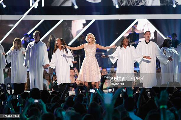 Carrie Underwood performs a tribute to the tornado victims of Moore Oklahoma during the 2013 CMT Music awards at the Bridgestone Arena on June 5 2013...