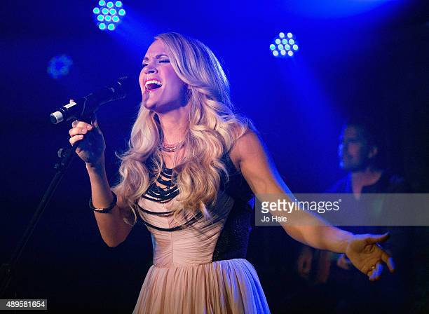 Carrie Underwood performs an Acoustic Set on stage at her Album Launch of 'Storyteller' at The Basement at The London Edition Hotel on September 22...