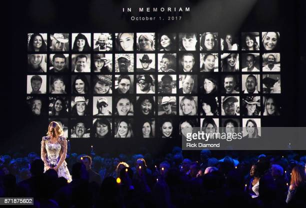 Carrie Underwood performs by a memoriam for the shooting victims of the Route 91 Harvest music festival in Las Vegas at the 51st annual CMA Awards at...