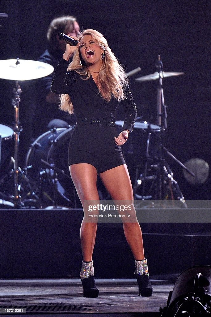 Carrie Underwood performs during the 47th annual CMA awards at the Bridgestone Arena on November 6, 2013 in Nashville, Tennessee.