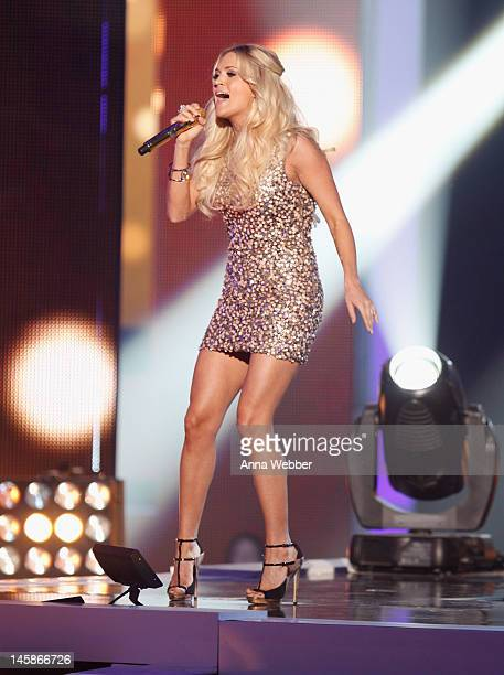 Carrie Underwood performs onstage at the 2012 CMT Music awards at the Bridgestone Arena on June 6 2012 in Nashville Tennessee