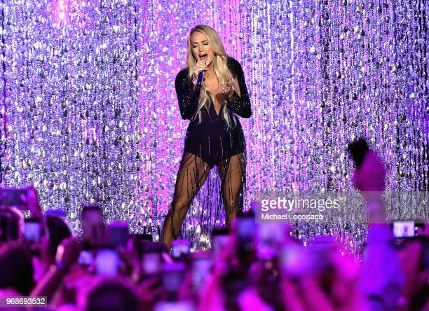 Carrie Underwood performs onstage at the 2018 CMT Music Awards at Bridgestone Arena on June 6 2018 in Nashville Tennessee