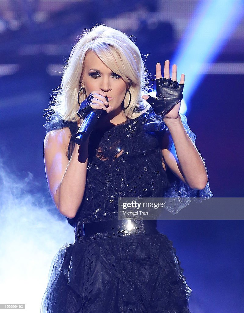 Carrie Underwood performs onstage at The 40th American Music Awards held at Nokia Theatre L.A. Live on November 18, 2012 in Los Angeles, California.