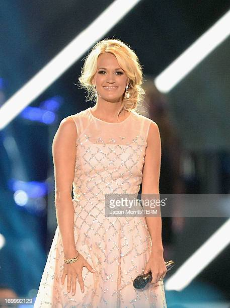 Carrie Underwood performs onstage during the 2013 CMT Music awards at the Bridgestone Arena on June 5 2013 in Nashville Tennessee