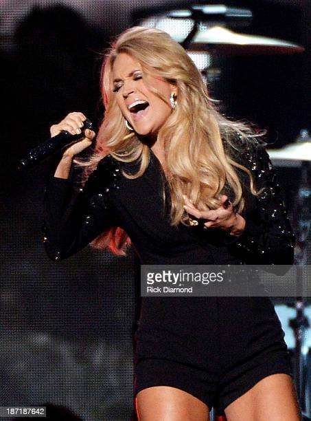 Carrie Underwood performs onstage during the 47th annual CMA Awards at the Bridgestone Arena on November 6 2013 in Nashville Tennessee