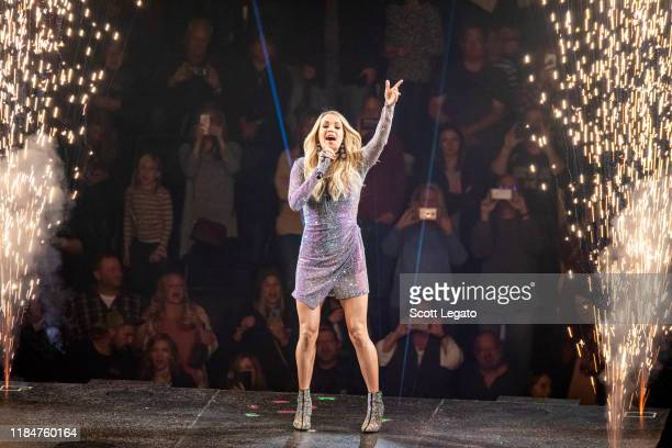 Carrie Underwood performs onstage during the Cry Pretty Tour 360 at Little Caesars Arena on October 31 2019 in Detroit Michigan