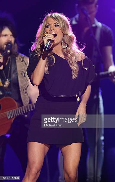 Carrie Underwood performs onstage during the iHeartRadio Country Festival at the Frank Erwin Center on March 29 2014 in Austin Texas