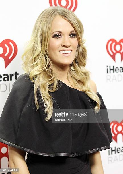 Carrie Underwood poses backstage at iHeartRadio Country Festival held at The Frank Erwin Center on March 29 2014 in Austin Texas