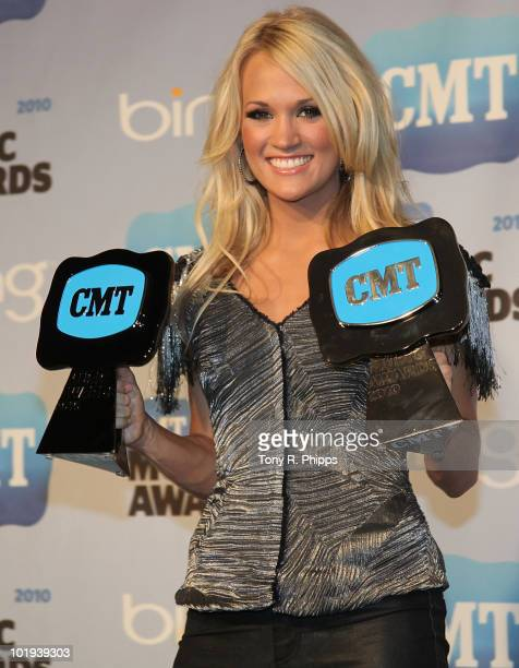 Carrie Underwood poses iin the Press Room at the 2010 CMT Music Awards at the Bridgestone Arena on June 9, 2010 in Nashville, Tennessee.