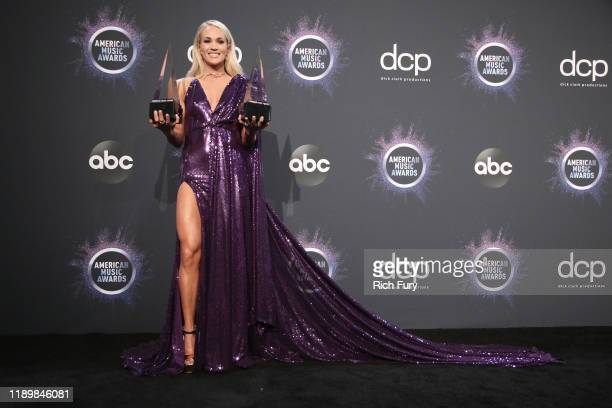 Carrie Underwood poses in the press room with the Favorite Album Country and the Favorite Female Artist Country awards during the 2019 American Music...