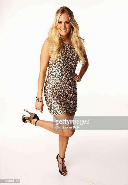 Carrie Underwood poses in the Wonderwallcom Portrait Studio during 2012 CMT Music awards at the Bridgestone Arena on June 6 2012 in Nashville...