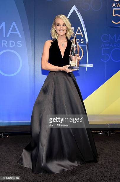 Carrie Underwood poses with award backstage during the 50th annual CMA Awards at the Bridgestone Arena on November 2 2016 in Nashville Tennessee