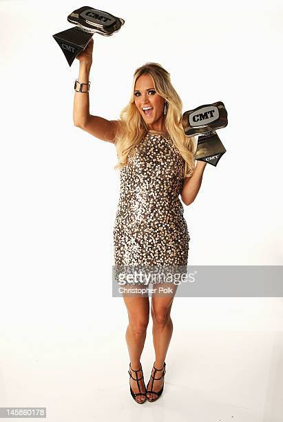 Carrie Underwood poses with awards in the Wonderwallcom Portrait Studio during 2012 CMT Music awards at the Bridgestone Arena on June 6 2012 in...