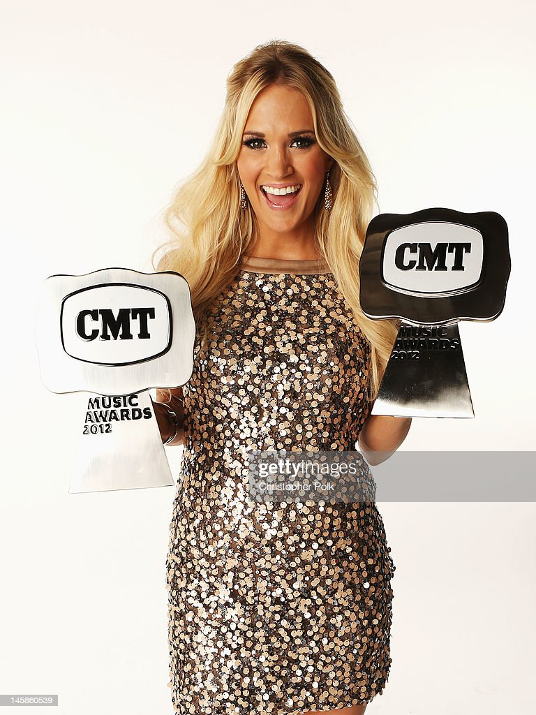Carrie Underwood poses with awards in the Wonderwall.com Portrait Studio during 2012 CMT Music awards at the Bridgestone Arena on June 6, 2012 in Nashville, Tennessee.