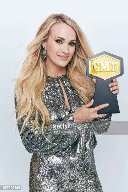 Carrie Underwood poses with CMT award for Female Video of the Year at the 2018 CMT Music Awards Show Portrait Studio at Bridgestone Arena on June 6...