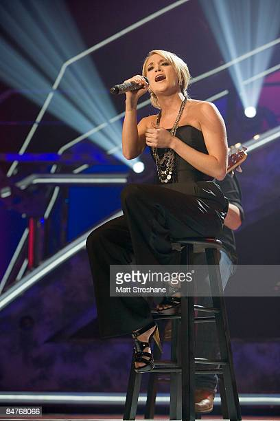Carrie Underwood season 4 winner performs during the grand opening show of the American Idol Experience at Disney's Hollywood Studios In Walt Disney...
