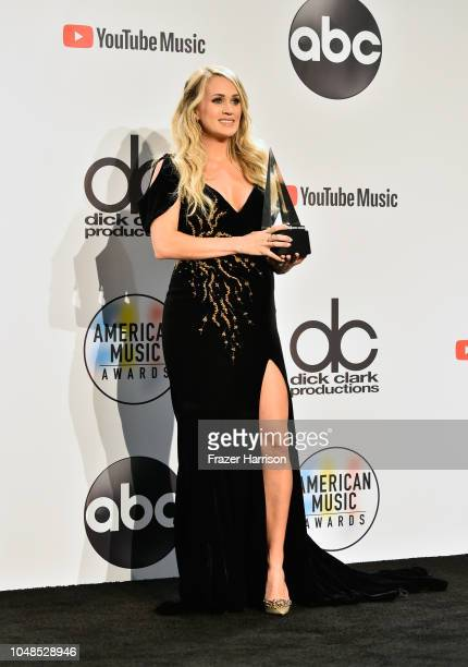 Carrie Underwood winner of the Favorite Female Artist Country award poses in the press room during the 2018 American Music Awards at Microsoft...