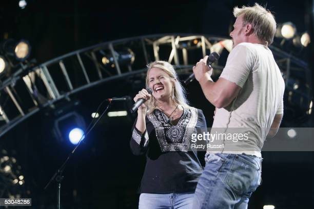 Carrie Underwood winner of TV show 'American Idol' performs with singer Phil Vassar at the CMA Music Festival June 9 2005 in Nashville Tennessee