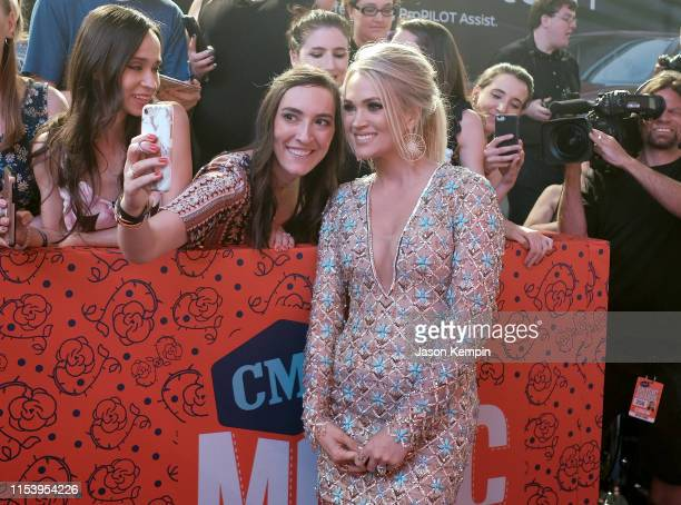 Carrie Underwood with fan at the 2019 CMT Music Awards at Bridgestone Arena on June 05 2019 in Nashville Tennessee